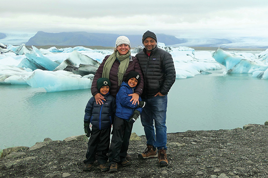 Sara Milles Gupta and family by an ice field.