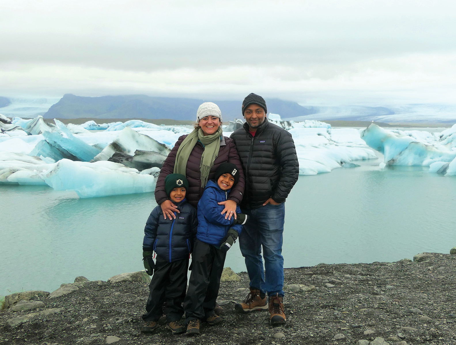 Sara Milles Gupta '02 with her family on a trip