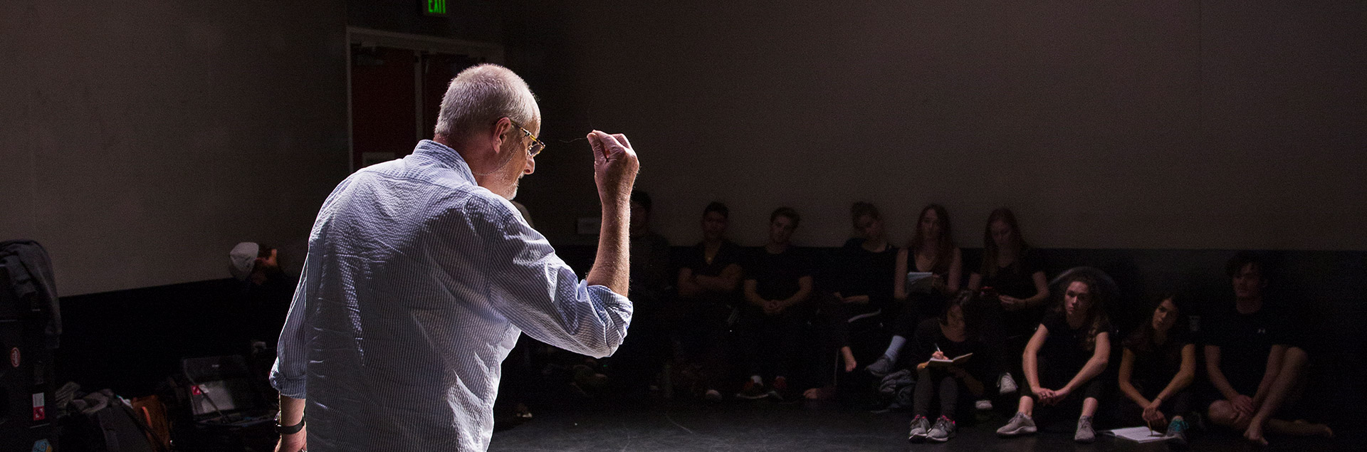 An instructor teaching a drama class in the Department of Theater and Dance.